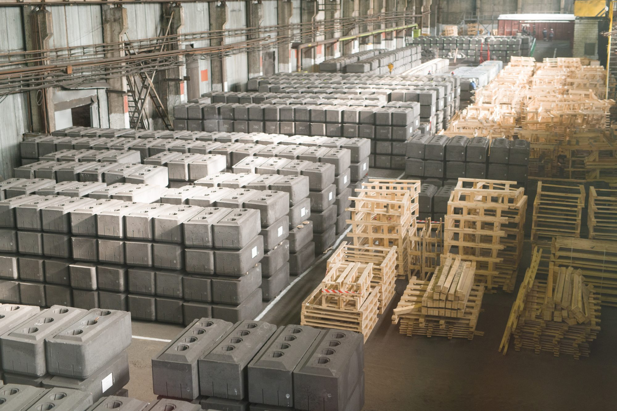 Background image on factory warehouse with concrete blocks or bricks ready for shipping in batches , copy space
