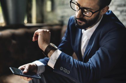 Man checking notifications on smart watch