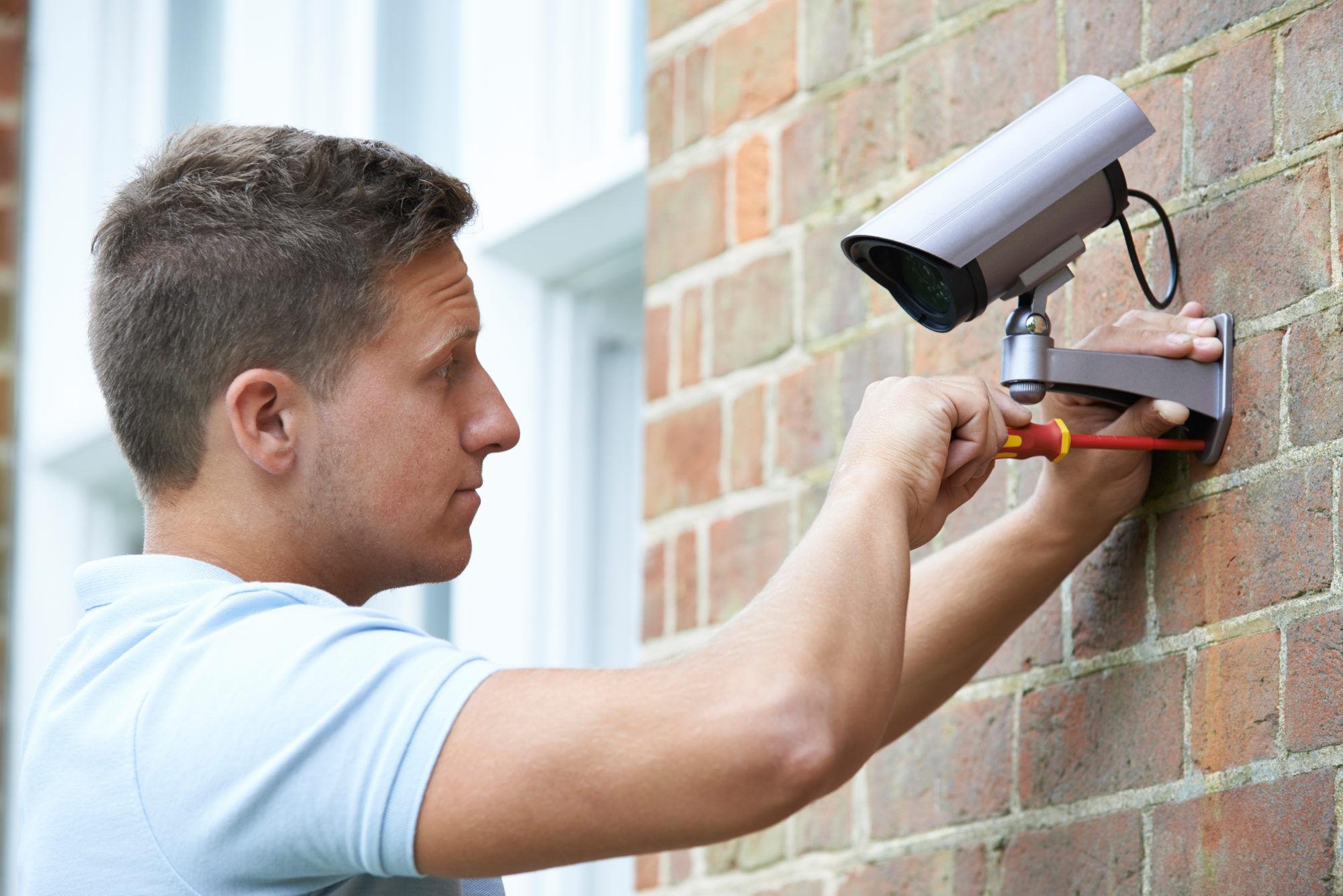 Certified technician installs security camera